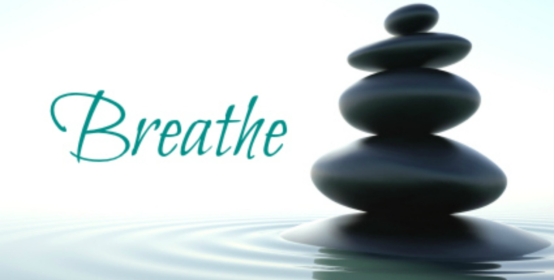 A zen stones skyscraper in a zen water on a white background